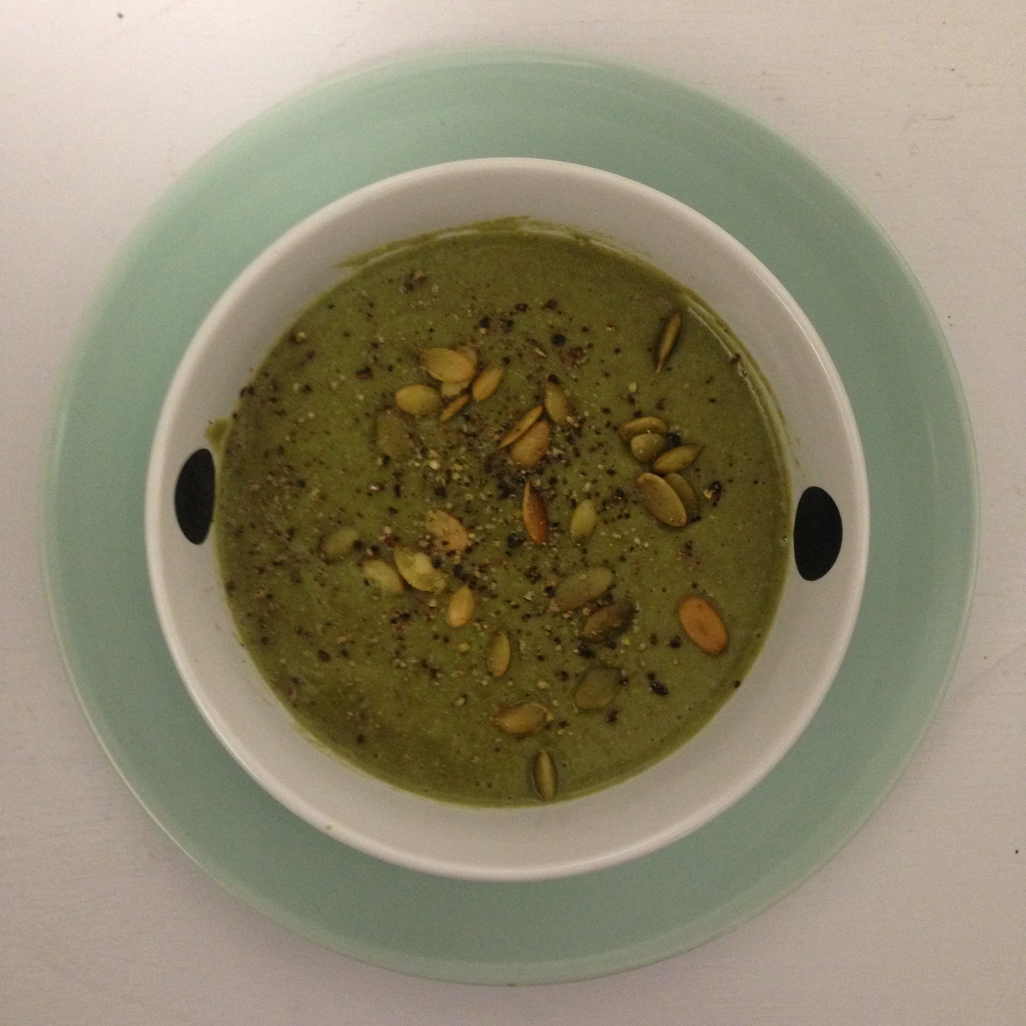 Rustic lentil & spinach soup with pumpkin seeds and black pepper ...